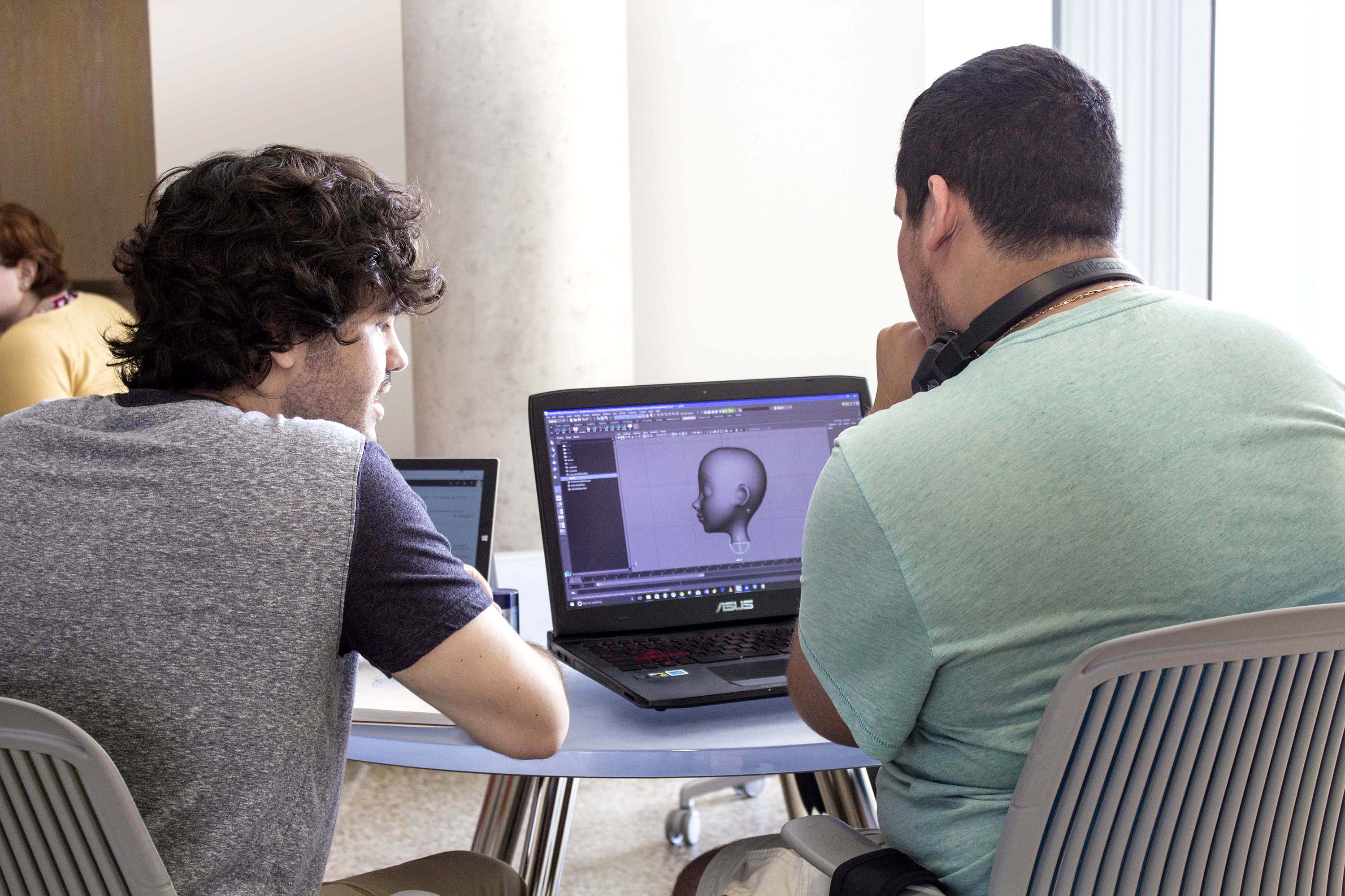 Animation students reviewing work