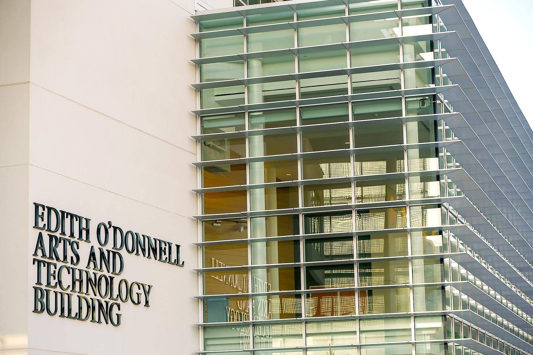 exterior signage of Edith O'Donnell Arts and Technology Building, slide 1