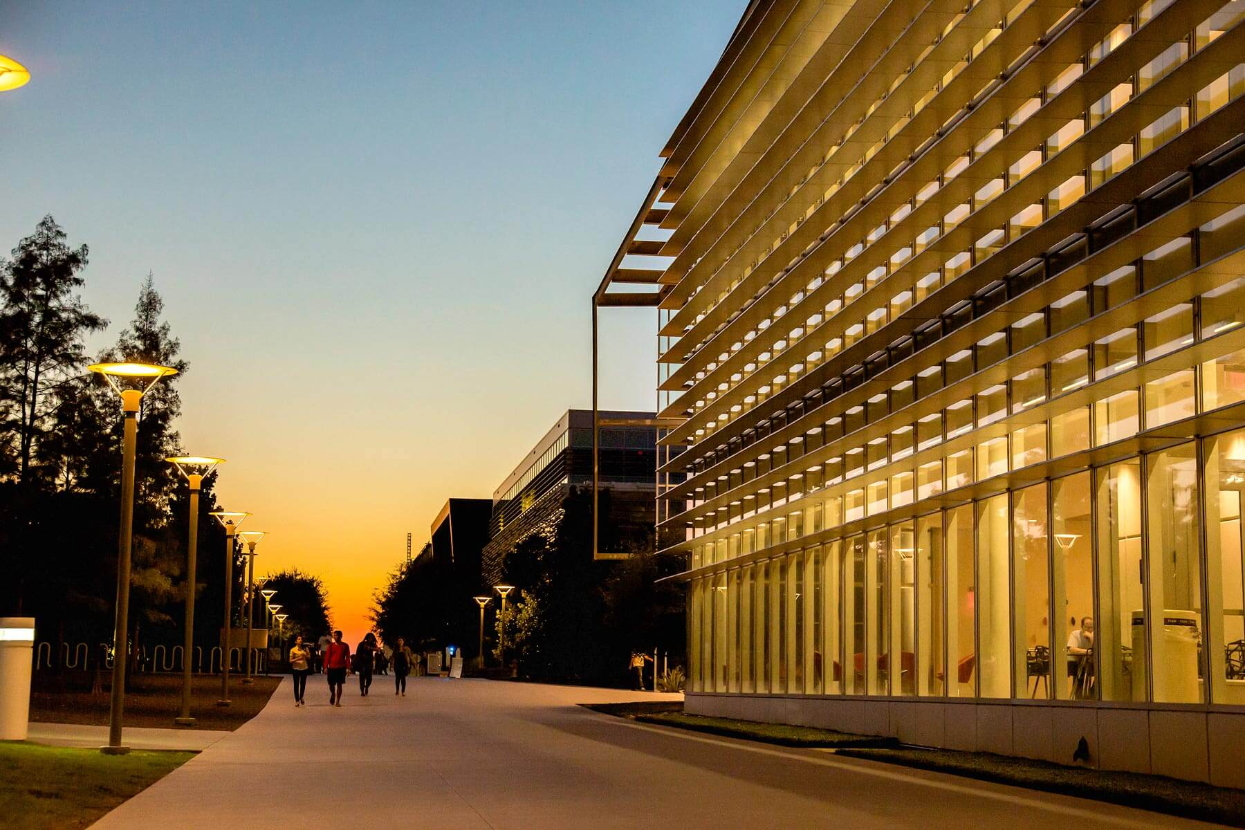 ATEC campus building at sunset, slide 5