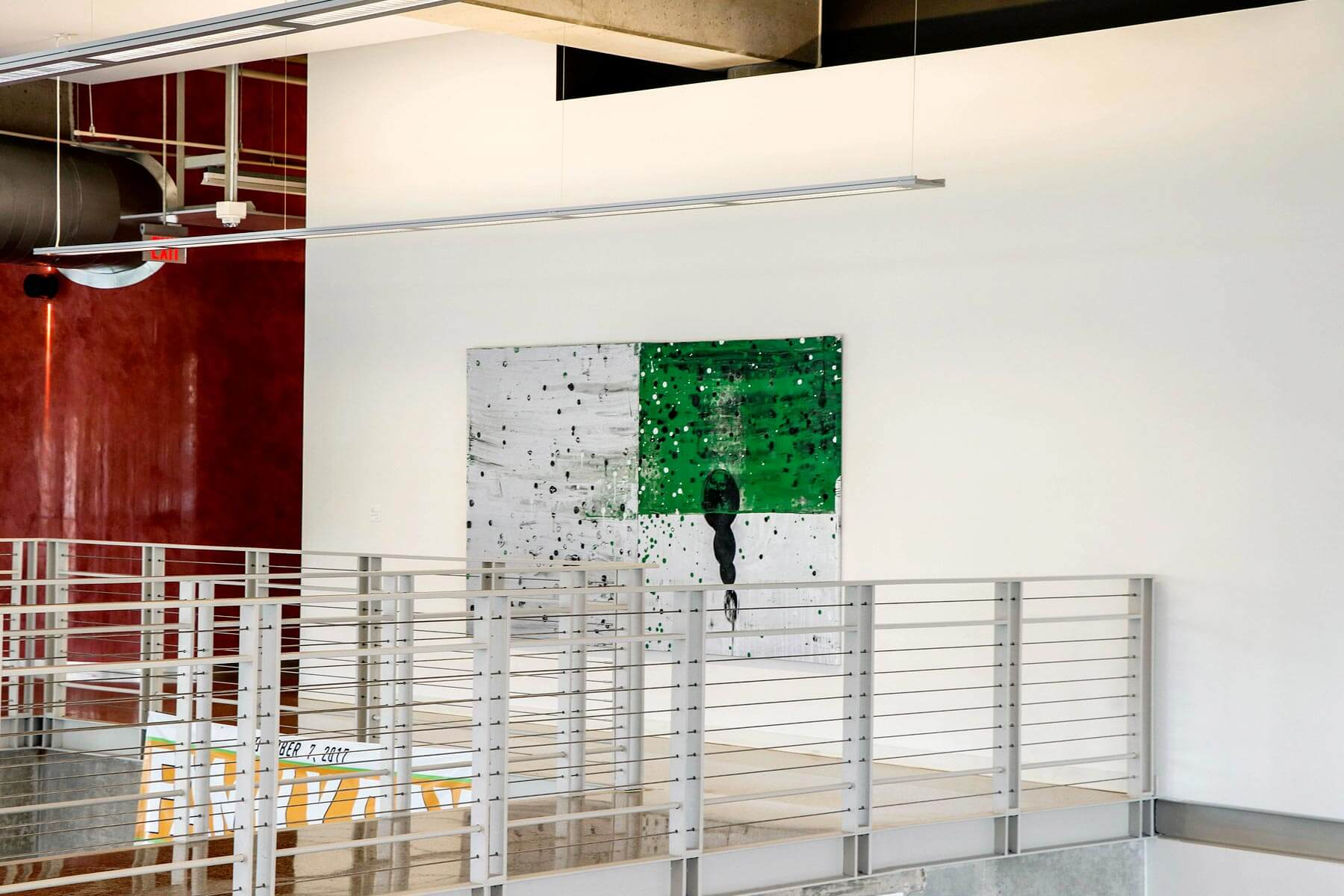 green and white painting inside ATEC building, slide 6