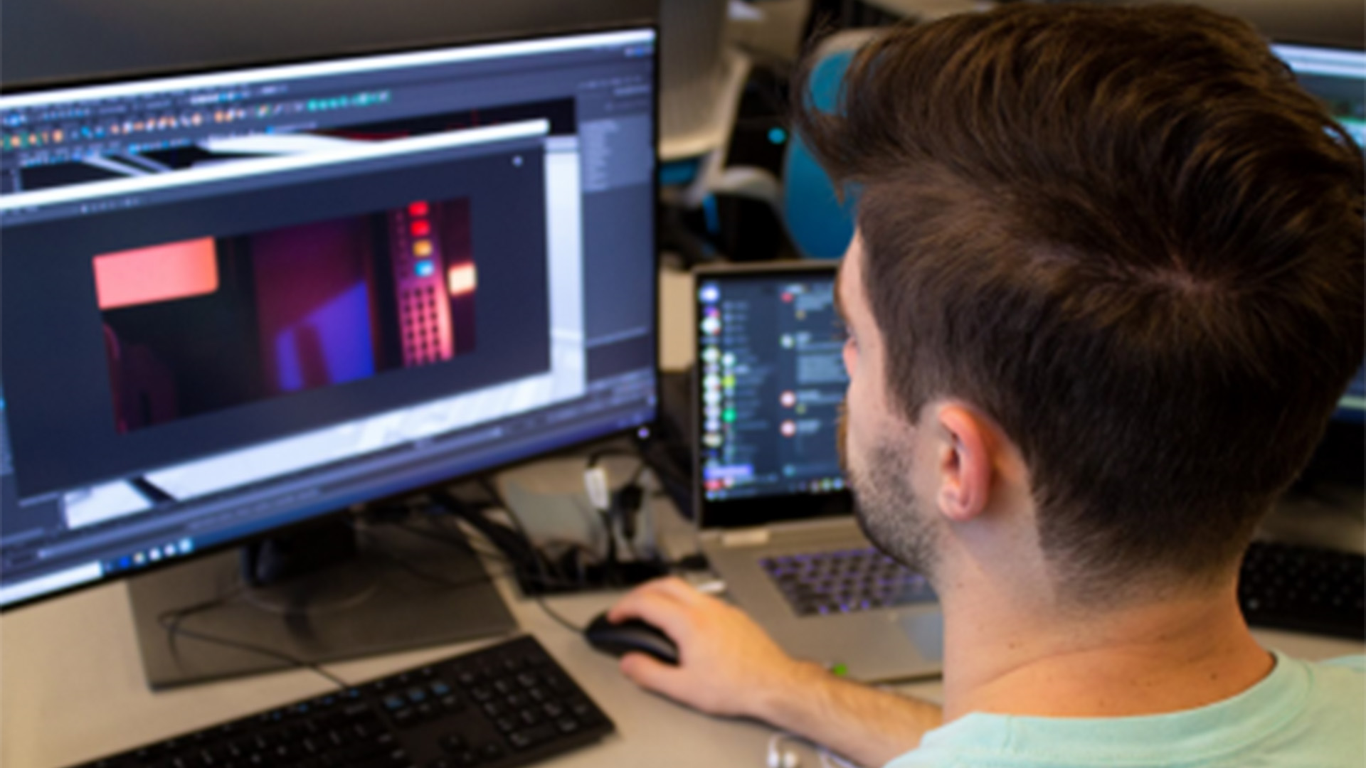 Student working on computer animation in CG lab